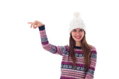 Woman in sweater and white hat holding something Stock Photos