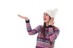 Woman in sweater and white hat holding something Stock Photography