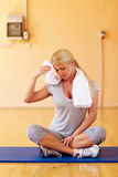 Woman sweating in gym Stock Photos