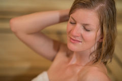 Woman sweating in sauna. Closeup of young woman sweating in sauna Stock Images