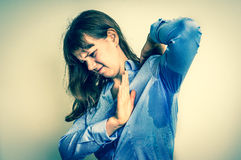 Woman with sweating under armpit - retro style. Young woman with sweating under armpit - retro style Stock Image