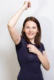 Woman sweating very badly under armpit and smiling Stock Photography