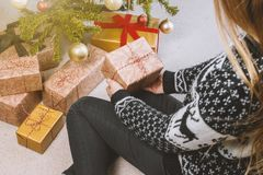 Woman in Sweatshirt and Jeans Holding a Gift Box royalty free stock photo