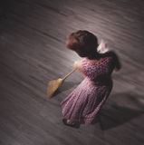 Woman sweeping. Overhead view of woman alone while sweeping Royalty Free Stock Photos
