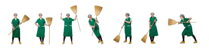 The woman with sweeping brush isolated on white. Woman with sweeping brush isolated on white royalty free stock photos