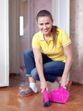Woman sweeping the floor Stock Photography