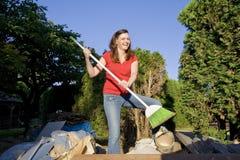 Woman Sweeping Through Garbage - Horizontal Royalty Free Stock Images