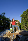 Woman Sweeping Through Garbage - Vertical Royalty Free Stock Photos