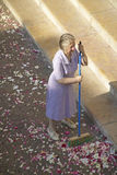 Woman sweeping up after Wedding Party, Antibes, France Royalty Free Stock Images