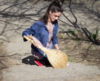 Woman sweeps with a sweeper Stock Photos