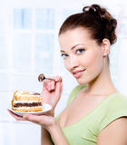 Woman with a sweet cake Stock Photo