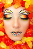 Woman sweet candy caramel with beautiful make-up young Royalty Free Stock Photography