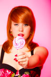 Woman with sweet candy lollipop in hand. Royalty Free Stock Photography