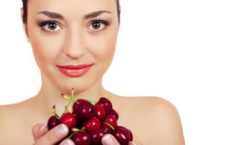 Woman with a sweet cherry Stock Photography