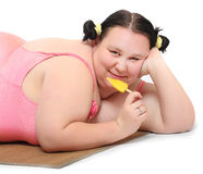 Woman with sweet ice lolly. Overweight woman with sweet ice lolly. Unhealthy lifestyle concept Stock Photos