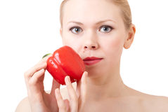 Woman with sweet pepper. Beautiful young woman holding a red sweet pepper Royalty Free Stock Photography