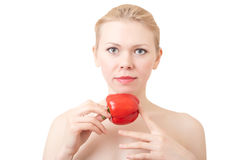 Woman with sweet pepper. Portrait of young woman with sweet pepper on a white background. Focus on a pepper Stock Images