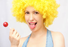 Woman with sweet sugar candy. Blonde woman with sweet sugar candy stock photo