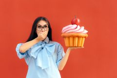 Funny Girl Holding Big Huge Giant Sweet Muffin Cupcake. Woman with a sweet tooth considering to eat huge patty cake Royalty Free Stock Image