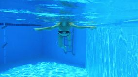 Woman swim in blue pool stock video