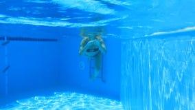 Woman swim in blue pool Stock Image