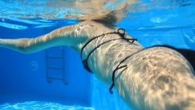 Woman swim in blue pool Royalty Free Stock Photo