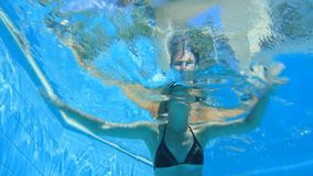 Woman swim in blue pool Royalty Free Stock Photography
