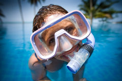 Woman in a swim mask. A young woman in a swim mask/goggles looking out of the water Royalty Free Stock Photography