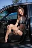 Woman in swim suit in car Stock Photo