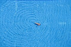 Woman swim in the swimming pool at the hotel. Top view. Turkey stock photography