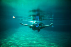 Woman swim underwater pool with snorkel Royalty Free Stock Image