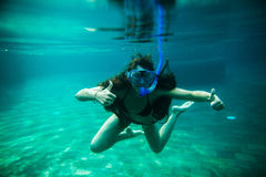 Woman swim underwater pool with snorkel Royalty Free Stock Photo