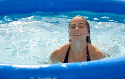 Woman swiming. A woman in a pool Stock Image
