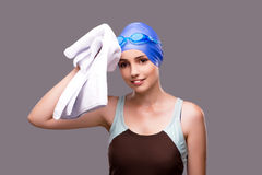 The woman swimmer against grey background Royalty Free Stock Photos
