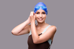 The woman swimmer against grey background Royalty Free Stock Photo