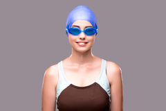 The woman swimmer against grey background Stock Images