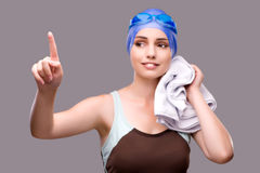 The woman swimmer against grey background Stock Photography