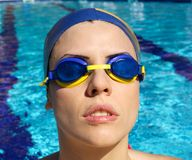 Woman swimmer concentrating before race Royalty Free Stock Photo