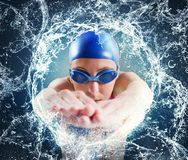 Woman swimmer. In a important pool race Stock Photography