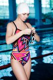Woman swimmer ready to swim Stock Images