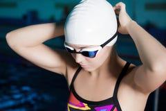 Woman swimmer ready to swim Stock Image