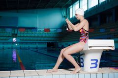 Woman swimmer ready to swim Stock Photos