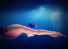 Woman swimmer. Swims under water in apnea Stock Images