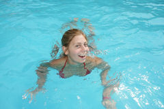 Woman swimming. Young woman swimming in the pool Royalty Free Stock Photos