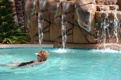 Woman swimming alone stock photo