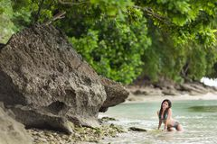 Woman swimming on a beautiful lush Royalty Free Stock Images