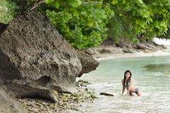 Woman swimming on a beautiful lush Stock Images