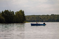 Woman swimming in boat. On lake Stock Images