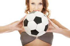 Woman in swimming bra with foot ball. Royalty Free Stock Photography