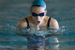 Woman swimming the Breaststroke stock image